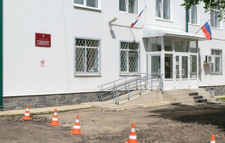 epidemiology: Orel, Russia - June 02, 2016: Entrance to the building of the Center for Hygiene and Epidemiology in Oryol region (inscription under sign NO SMOKING)