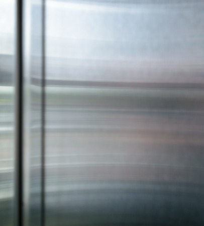 shiny metal: Polished shiny steel metal surface with multicolored reflections and glare.