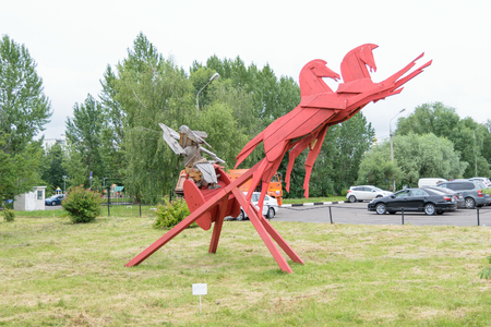 pedagogical: Moscow, Russia - July 07, 2016: Wooden sculpture rides horses with chariot near the building of the Moscow State Pedagogical University