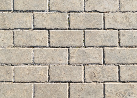 Background in the form of gray masonry of lime sand brick Stock Photo