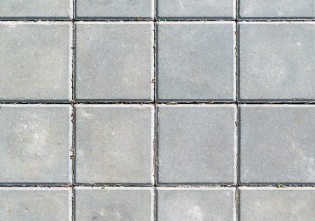 The surface of the gray square concrete slabs