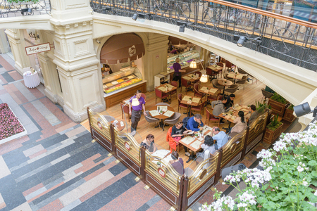 bosco: Moscow, Russia - July 07, 2016: People sit at tables in the cafe BOSCO in GUM on Red Square