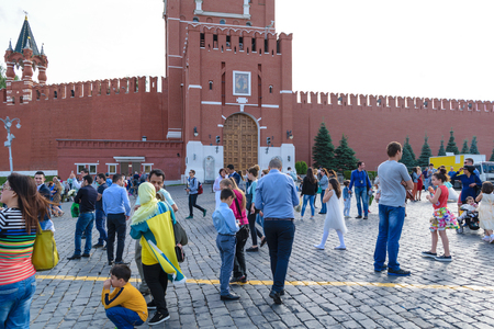 spassky: Moscow, Russia - July 07, 2016: Tourists on the Red Square in front of Borovitsky gate of the Moscow Kremlin Spassky Tower Editorial