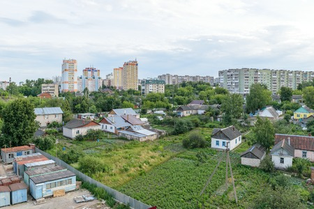 Garden plots and orchards near the multi-storey residential buildings in the city. Stock Photo