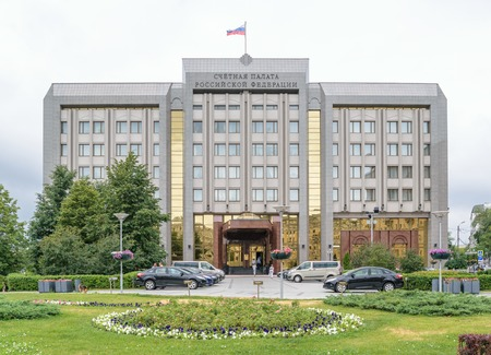 parliamentary: Moscow, Russia - July 14, 2016: Russian Audit Chamber - parliamentary body of financial control. People and cars in front of the building