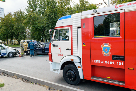 Orel, Russia - September 27, 2016: Red firefighter car brought rescuers from the Ministry of Emergency Situations for liquidation of consequences of road accident