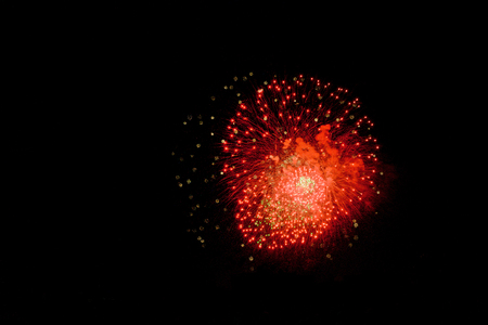 Holiday fireworks of colored lights isolated on the black background of the night sky.