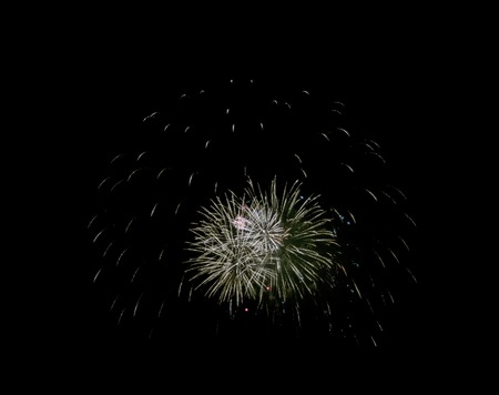 Holiday fireworks of colored lights isolated on black background of the night sky.
