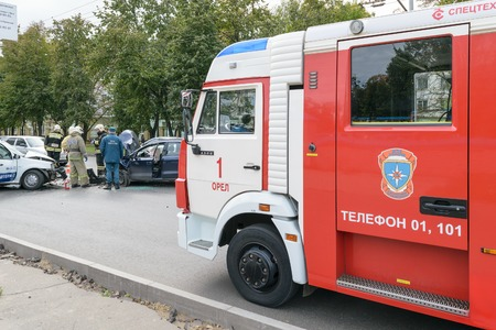 Orel, Russia - September 27, 2016: Firefighter car in place of collision between two cars. Rescuers work Editorial