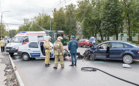Orel, Russia - September 27, 2016: Rescue workers and ambulance car on place of traffic incident, the collision of two cars