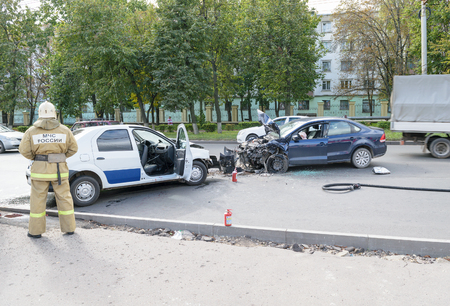 Worker of the Ministry of Emergency Situations (rescuer) in place of traffic accident (collision of two cars). Editorial