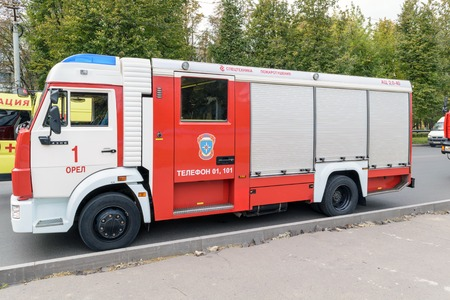 Orel, Russia - September 27, 2016: Firefighter car standing on the road next to the car of ambulance Editorial
