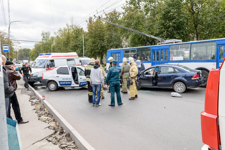 Orel, Russia - September 27, 2016: Employees of the Ministry of Emergency Situations (rescuers) and car of ambulance medical care in place of road traffic accident