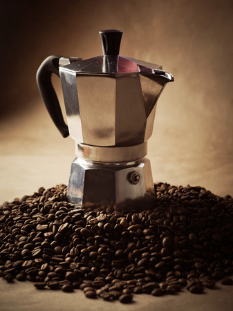 poke: Coffee pot and coffee beans. Paper texture coffee. Dark coffee roasted. Bag of coffee, spill. Coffee beans