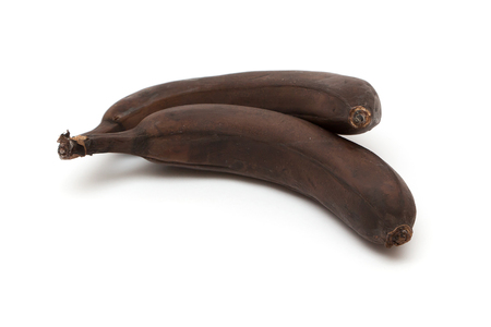 frowzy: Two overripe bananas isolated on white background