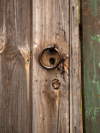 door handle: Old wooden door and door handle Stock Photo