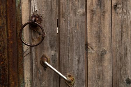 cranny: Old wooden door and door handle Stock Photo