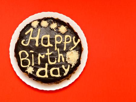 glaze: Birthday cake with dark chocolate glaze and lettering Stock Photo