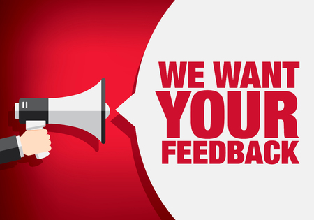We want your feedback. Hand holding megaphone
