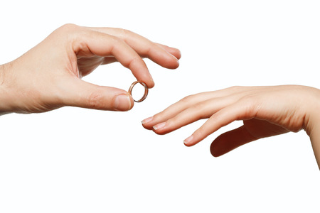 ring finger: male and female hand with a wedding ring Stock Photo