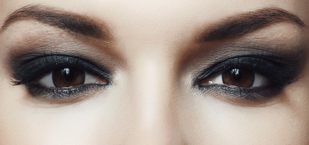 beautiful female brown eyes with bright makeup
