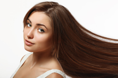 long silky hair: young and beautiful girl with long silky hair and perfect makeup Stock Photo