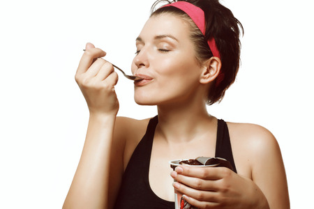 young and beautiful woman eating a delicious ice cream with chocolate