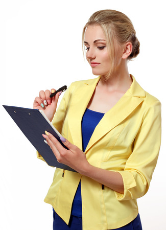 business lady in a suit with a folder and pen in hand