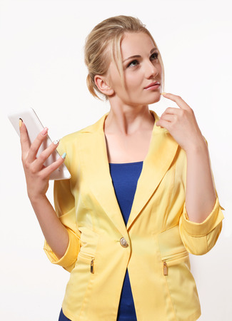 largest white mobile phone, smart business woman thinking what to write in the message
