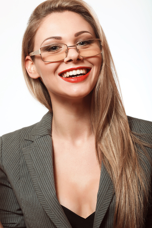 white teeth, funny and beautiful blonde with long hair in a business suit