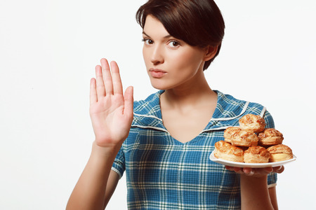 Dish of bakery products in the hands of women, diet Фото со стока