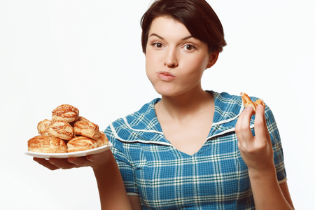 beautiful and lovely girl eating baked goods, diet Фото со стока