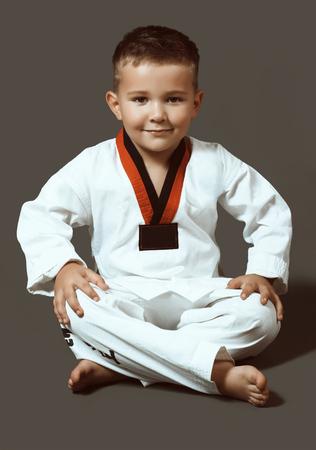 little boy with green eyes in white kimono Фото со стока