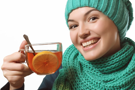 rheum: young girl holding a lemon tea and smiling