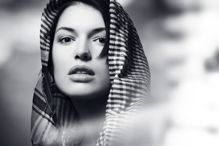 adult sexy: beautiful girl wearing a scarf, portrait, black and white
