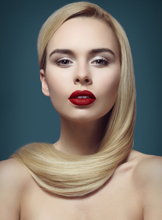 makeup, beautiful and young blonde with long groomed hair Stock Photo