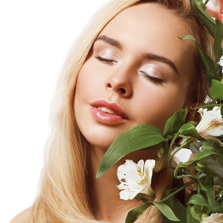 young and beautiful blond girl with pink flowers in her hair