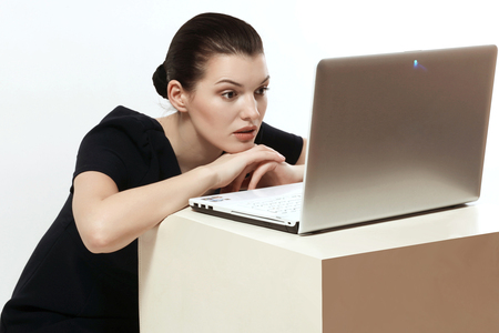 beautiful and intelligent girl working in a laptop, emotions