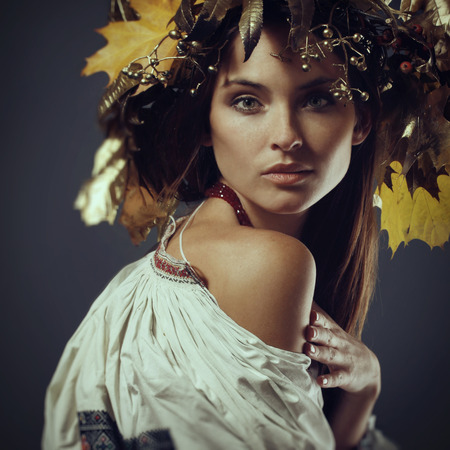 Beautiful green-eyed girl in a wreath, freckles, embroidery, beauty