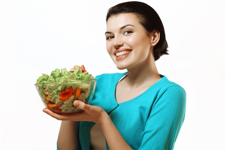 Beautiful and happy woman holding a salad. Fresh vegetables, healthy diet.