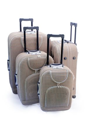 luggage pieces: Four beige travel suitcases (trolley) - isolated
