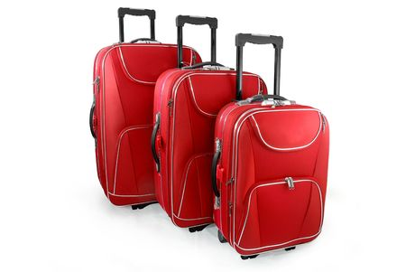 luggage pieces: Three red travel suitcases (trolley) - isolated