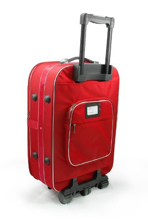 luggage pieces: Red travel suitcase (trolley) - isolated