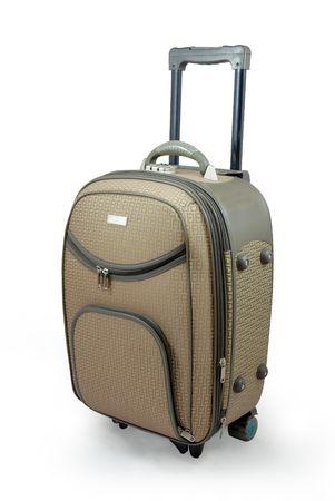 Beige travel suitcase - isolated Standard-Bild
