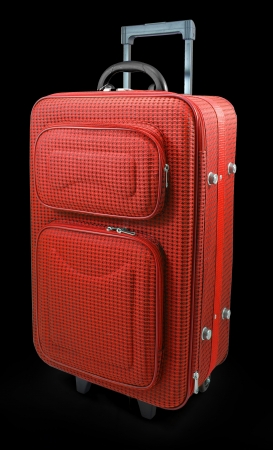 Red travel suitcase - isolated on black