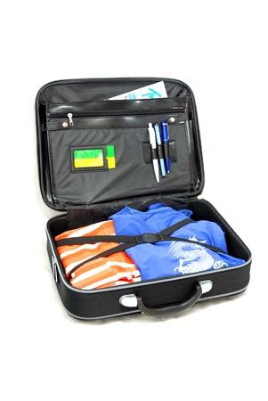Opened vacation baggage  black suitcase  - isolated on white