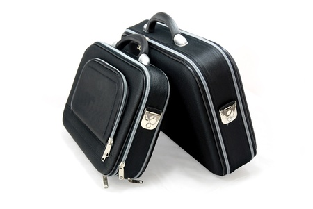 luggage pieces: Two black suitcases - vacation baggage - isolated
