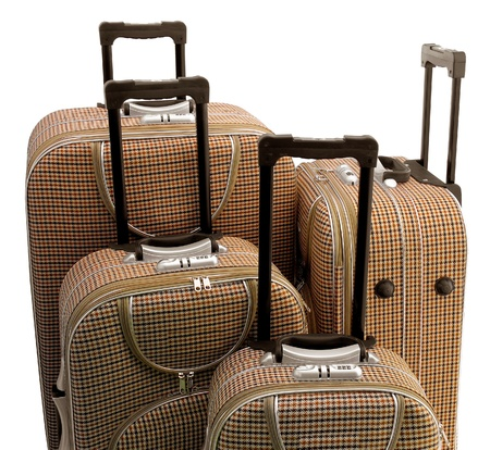 Four beige travel suitcases  trolley  - isolated  photo