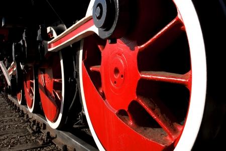 Vintage steam engine locomotive train on railroad track
