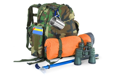 Military backpack with tourist equipment - isolated on white photo